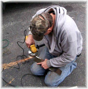 Chris Bert sharpening lawn mower blades 10/28/11