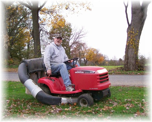 Chris Bert mowing lawn 10/28/11