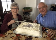 Jim and Dorothy Schmidt with cake, 4/3/19