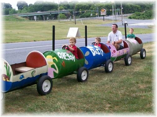 Ken and boys riding barrell train
