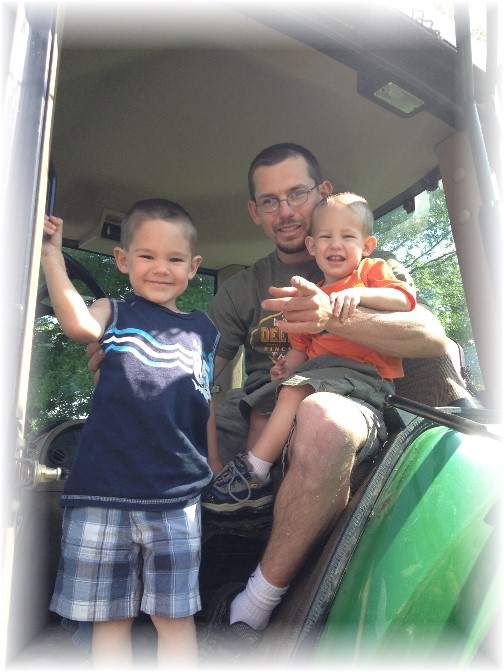 Mike Gardner and sons in tractor cab 6/14/14