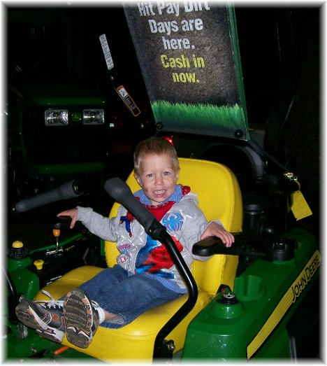 Zachary on John Deere tractor at Manheim farmshow