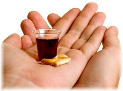 Communion elements in hand