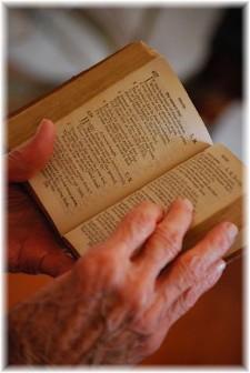 Elderly hands holding Bible