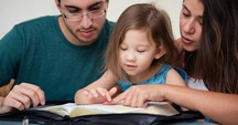 Reading Bible to child