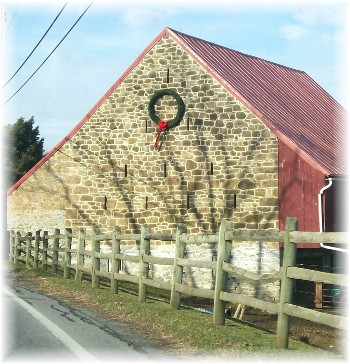 Wreath on stone barn