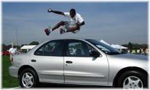 Man jumping over car