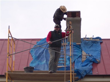 Laborer on scaffold