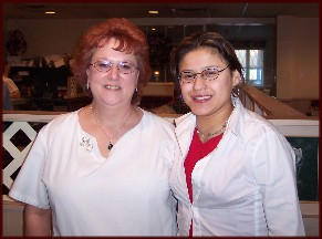 Ester with waitress at Esther's Restaurant