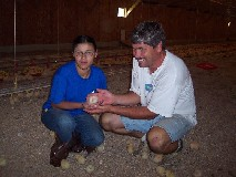 Photo of Ester with her youth group leader Stan in Chicken House