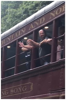 Waving from train