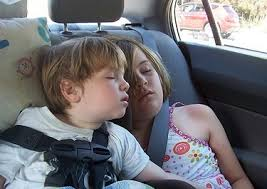 Children sleeping in car