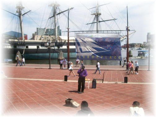 Street musician in Baltimore's inner harbor