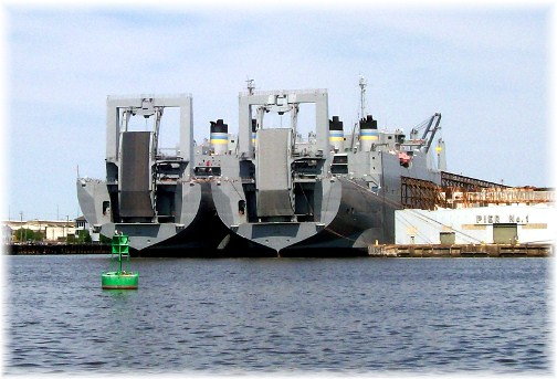 Large naval roll-on/roll-off cargo ships in Baltimore's inner harbor
