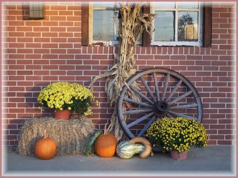 Photo of wagon wheel with fall display