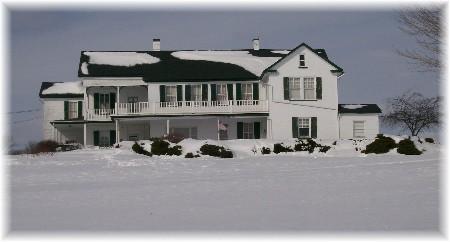 Brick farmhouse in snow