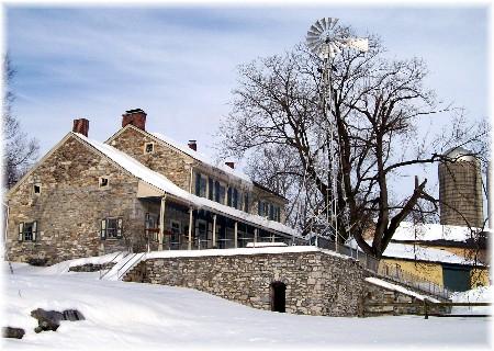 Stone farmhouse in snow